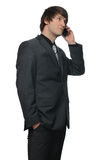 Portrait of a young businessman using mobile phone Stock Photos
