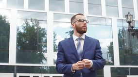 Portrait of young businessman wearing glasses. stock video footage