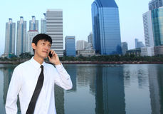 Portrait of young businessman wearing glasses and using smartpho. Ne Stock Image