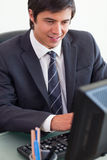 Portrait of a young businessman working with a computer Stock Photography