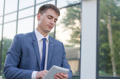 Portrait of  young businessman. Businessman working with his laptop. Handsome young man Royalty Free Stock Photo