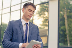 Portrait of  young businessman. Businessman working with his laptop. Handsome young man Stock Images