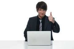 Portrait of a young businessman working on laptop Royalty Free Stock Photo