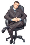 Portrait of young businessmen sitting on chair Stock Photography