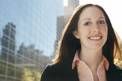 Portrait of Young Businesswoman Against Office Building Royalty Free Stock Image