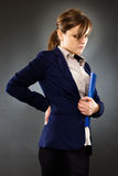 Portrait of a young businesswoman with back pain Royalty Free Stock Image