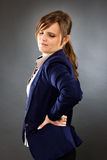 Portrait of a young businesswoman with back pain Royalty Free Stock Photos
