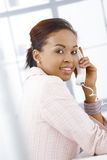 Portrait of young businesswoman on call Stock Images