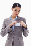 Portrait of a young businesswoman clipping her badge Royalty Free Stock Photos