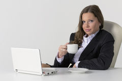 Portrait of young businesswoman with coffee using Royalty Free Stock Images