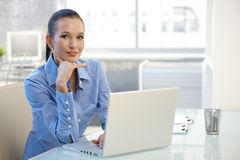 Portrait of young businesswoman with computer Royalty Free Stock Image