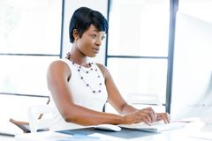 Portrait of businesswoman working at her desk in office Royalty Free Stock Images