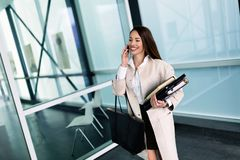 Portrait of young businesswoman going to office stock images