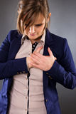Portrait of a young businesswoman having a pain in the heart are Stock Photography