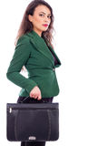 Portrait of a young businesswoman holding a briefcase Stock Photography