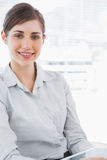 Portrait of a young businesswoman holding tablet pc Stock Images