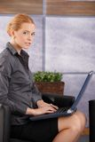 Portrait of young businesswoman with laptop Stock Photos