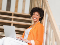 Portrait of young businesswoman with laptop. Portrait of young businesswoman in office holding laptop Royalty Free Stock Photo