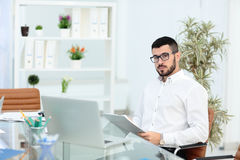 Portrait of a young businesswoman in modern office. Portrait of a young businesswoman in office Royalty Free Stock Images