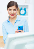 Portrait of young businesswoman in office on phone Royalty Free Stock Photography