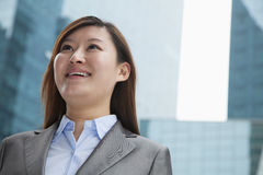 Portrait of young businesswoman outdoors among skyscrapers Royalty Free Stock Images