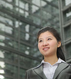 Portrait of young businesswoman outdoors among skyscrapers Stock Photos