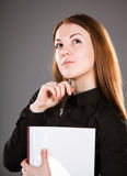 Portrait of a young businesswoman with pen and documents Stock Photo