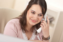 Portrait of young businesswoman on phone at office Royalty Free Stock Image