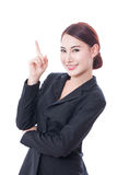 Portrait of young businesswoman pointing up Royalty Free Stock Image