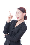 Portrait of young businesswoman pointing up Royalty Free Stock Photo