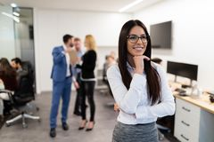 Portrait of young businesswoman posing in office royalty free stock image
