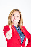 Portrait of young businesswoman showing hand ok sign Stock Photo