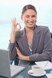 Portrait of a young businesswoman signing that everything is okay Stock Photography