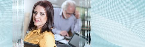Portrait of young businesswoman sitting at desk, light effect; panoramic banner. Portrait of young businesswoman sitting at desk in office, light effect stock image