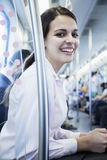 Portrait of young businesswoman sitting on the subway and looking at the camera Stock Image