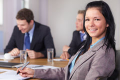 Portrait of young businesswoman sitting at table Stock Images