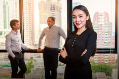 Portrait of young businesswoman smiling at camera on background Royalty Free Stock Images
