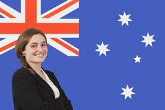 Portrait of young businesswoman smiling over Australian flag Royalty Free Stock Photography