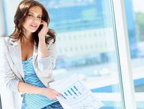 Portrait of young businesswoman talking on mobile Royalty Free Stock Photos