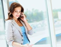 Portrait of young businesswoman talking on mobile Stock Images