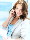Portrait of young businesswoman talking on mobile Stock Photography