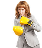 Young businesswoman wearing boxing gloves Stock Images