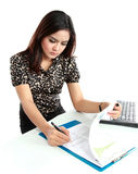 Portrait of a young businesswoman working with papers in office Stock Images