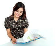 Portrait of a young businesswoman working with papers in office Stock Photography