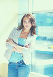 Portrait of young busineswoman standing in office lobby.  Stock Photography