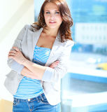 Portrait of young busineswoman standing in office lobby.  Royalty Free Stock Photography
