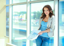 Portrait of young busineswoman standing in office lobby.  Royalty Free Stock Photo
