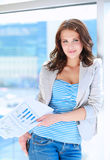 Portrait of young busineswoman standing in office lobby.  Stock Photo