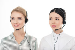 Portrait of young call center operators in headsets Stock Images