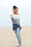 Portrait of a young carefree woman walking on the beach Royalty Free Stock Image